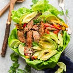 Steak Fajita Salad is the perfect hearty and low carb lunch or light dinner. Best of all, it has all the amazing flavors of a fajita served with a creamy cilantro lime dressing!