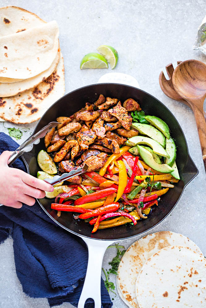 Low Carb Chicken Fajitas - a quick, simple and tasty one pan meal with minimal clean-up. Just 30 minutes and perfect for busy weeknights. Serve over a bed of lettuce, cauliflower rice or with keto wraps