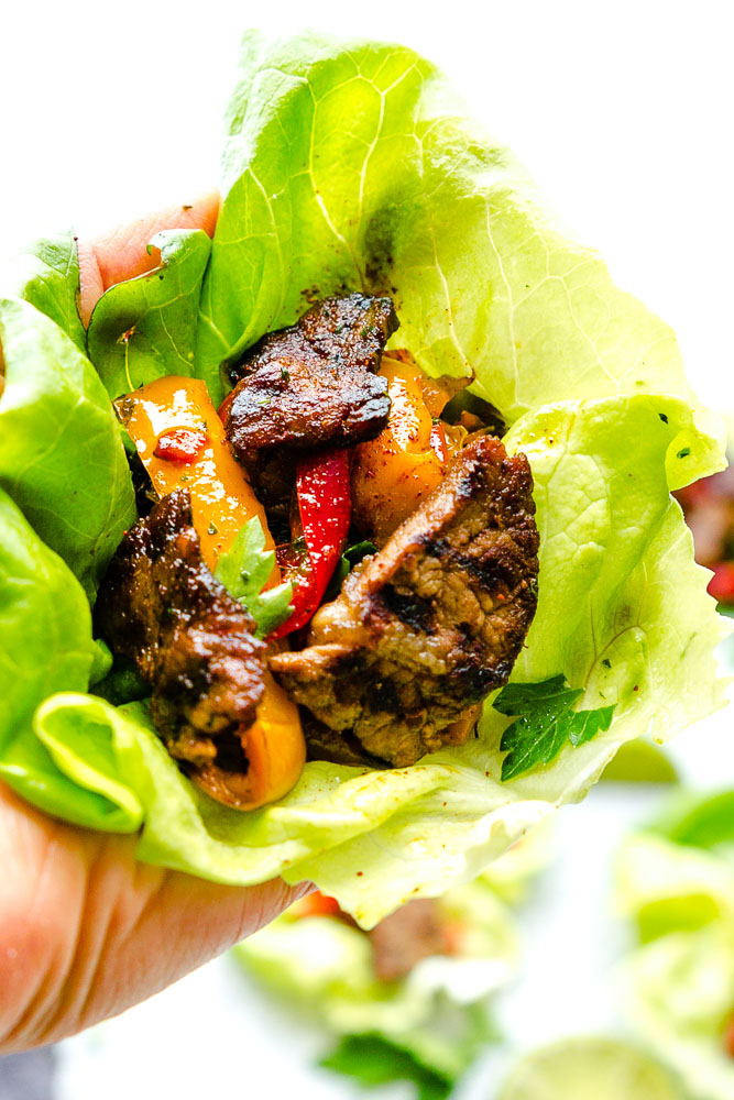 These Chili Lime Steak Fajita Lettuce Wraps are fresh, flavorful and super easy to make! They make the perfect handheld appetizers or a light and healthy low-carb lunch or dinner!