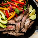 Low Carb Skillet Steak Fajitas are tender, juicy and full of flavor! Best of all, this easy recipe comes together super quick and perfect for busy weeknights. Marinated in a homemade fajita spice blend and cilantro lime marinade.