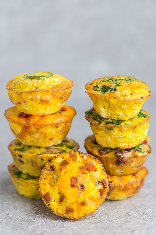Low Carb Ham and Cheddar Cheese Egg Cups - a quick and easy grab and go breakfast for busy mornings. Simple to customize, keto friendly and full of protein.