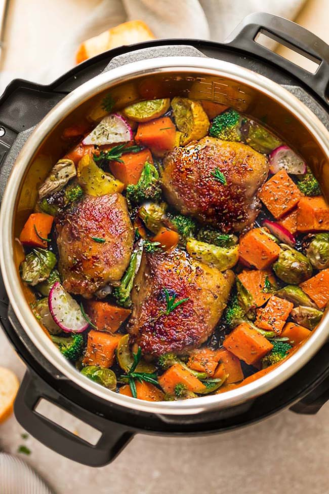 This Instant Pot Chicken with Autumn Vegetables if full of cozy fall flavors and perfect for busy weeknights. Made with tender, juicy chicken thighs, Brussels sprouts, pumpkin and broccoli.