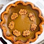 A delicious low carb pumpkin pie recipe with all the delicious flavors of a traditional pumpkin pie. Made with a flaky and buttery crust with a smooth and creamy Paleo-friendly custard filling with cozy fall spices.
